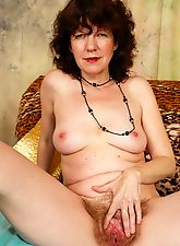 Horny old broad has bushy beaver