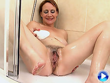 Tiffany T rubs her hairy pussy in the shower