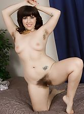 Laying on her bed leaves Simone naked and frisky
