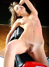 hairy muff, Risha is a biker girl with a small fun bush she presses down into the leather of her hot bike