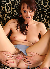 Older brunette with a furry pussy enjoys her platsic friend here