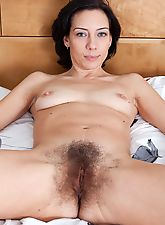 Eva pinches her pink puffy nipples