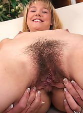Charlotte spreads her hairy pussy on the couch